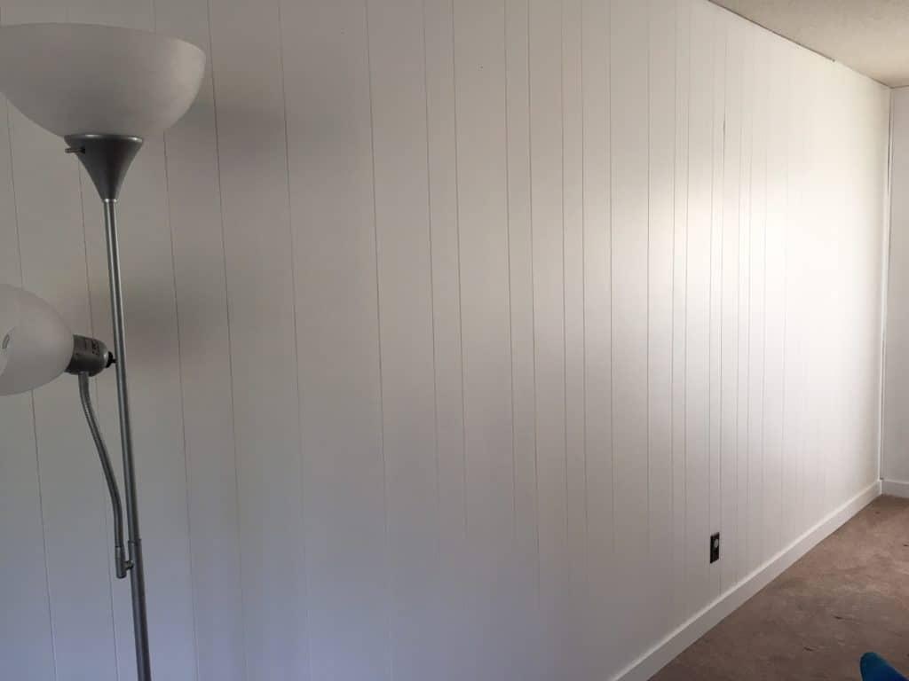 Wood paneling painted white