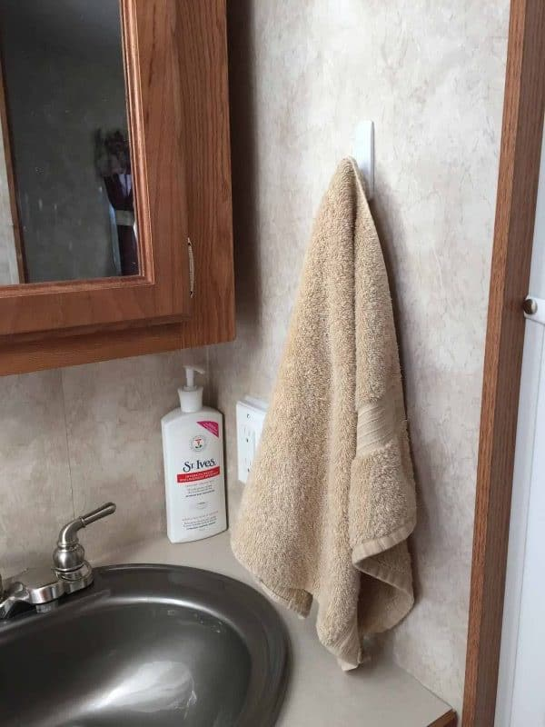 Command hook towel holder can make a good camper towel rack that adheres to the wall.