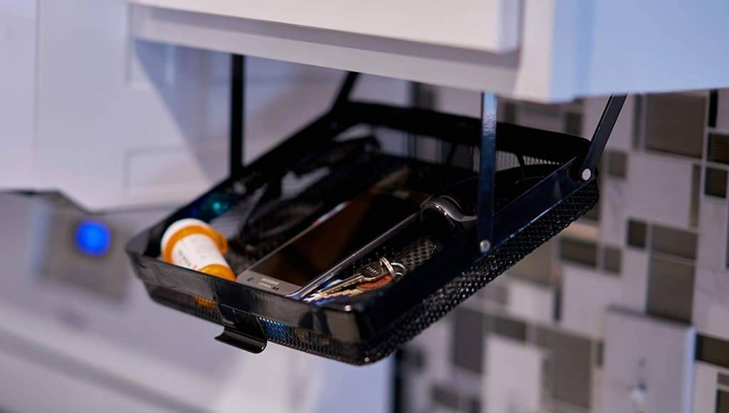 RV Storage idea -> flip down organization tray that attaches to the underside of the cabinet