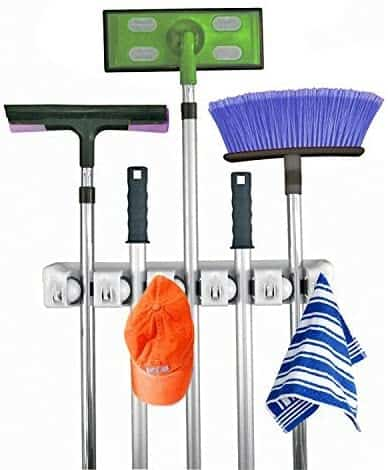 Broom holder and other long-handled tools holder  to improve garage storage ideas.