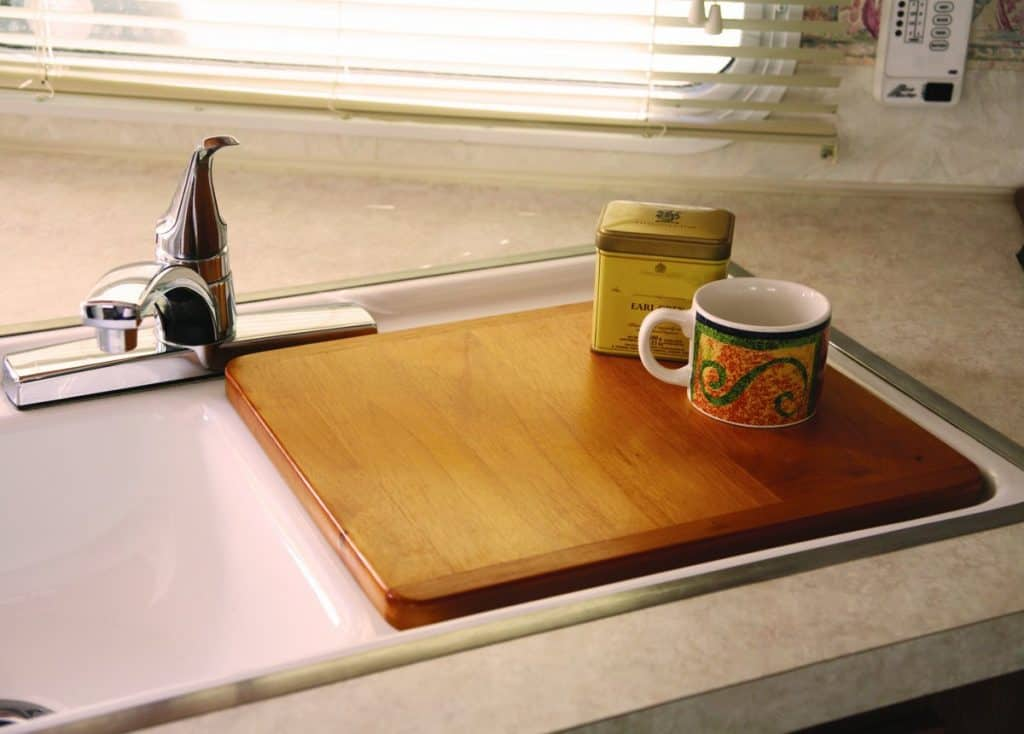 RV Kitchen Organization Sink covers help improve space in your RV because they give you more counter-top surface.