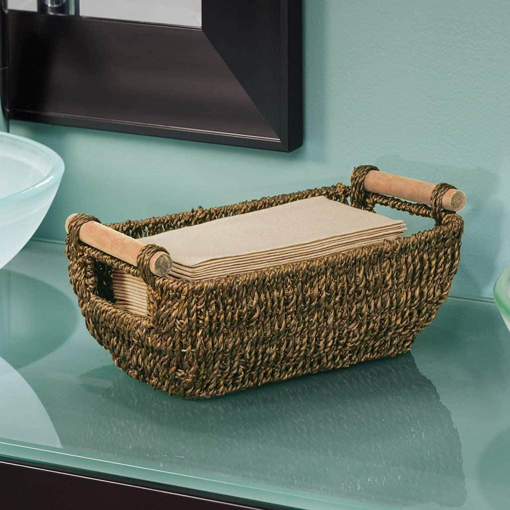 RV Bathroom storage ideas - a seagrass basket makes a lovely holder for your towels and toiletries