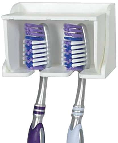A wall mounted toothbrush holder like this one helps get stuff off your RV bathroom counter. It makes a great RV organization accessory.
