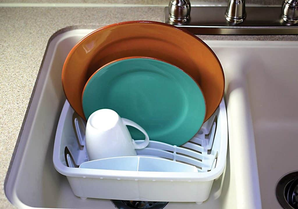 RV Kitchen organization ideas. A small dish drying rack that fits inside the sink helps organize your rv kitchen counter