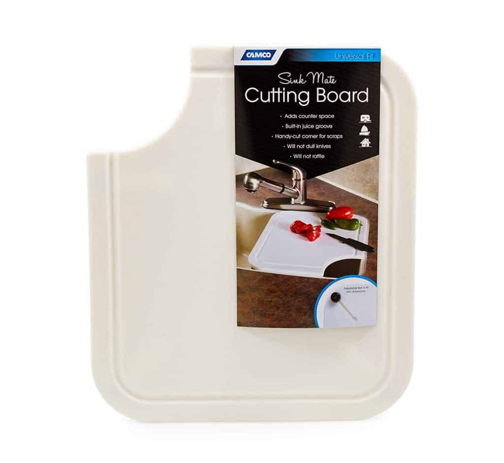 RV kitchen organization ideas. A cutting board that goes over the sink is a great RV kitchen organization accessory because it gives you more counter top space.