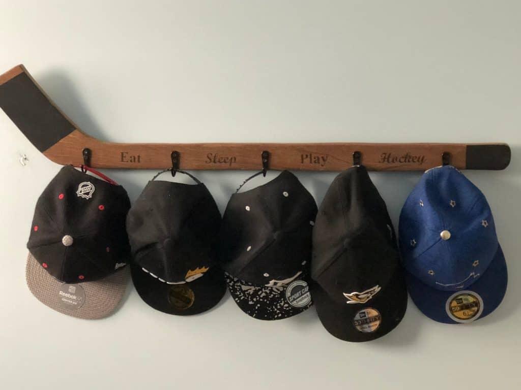 Entryway organizer - hockey stick coat rack