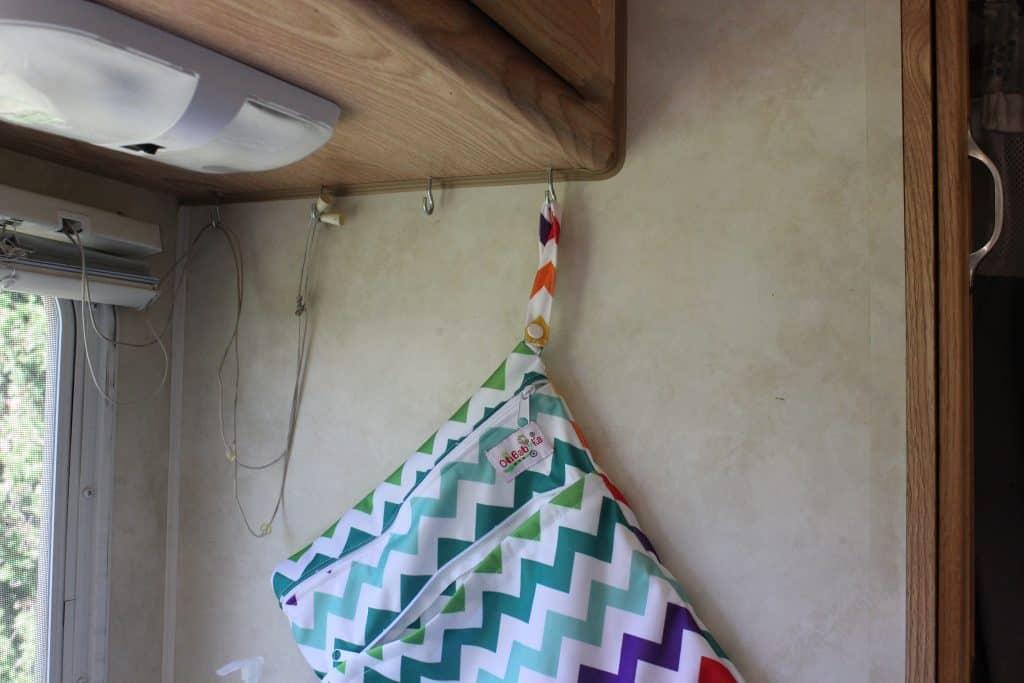 Wooden hooks make a good RV kitchen organization hack