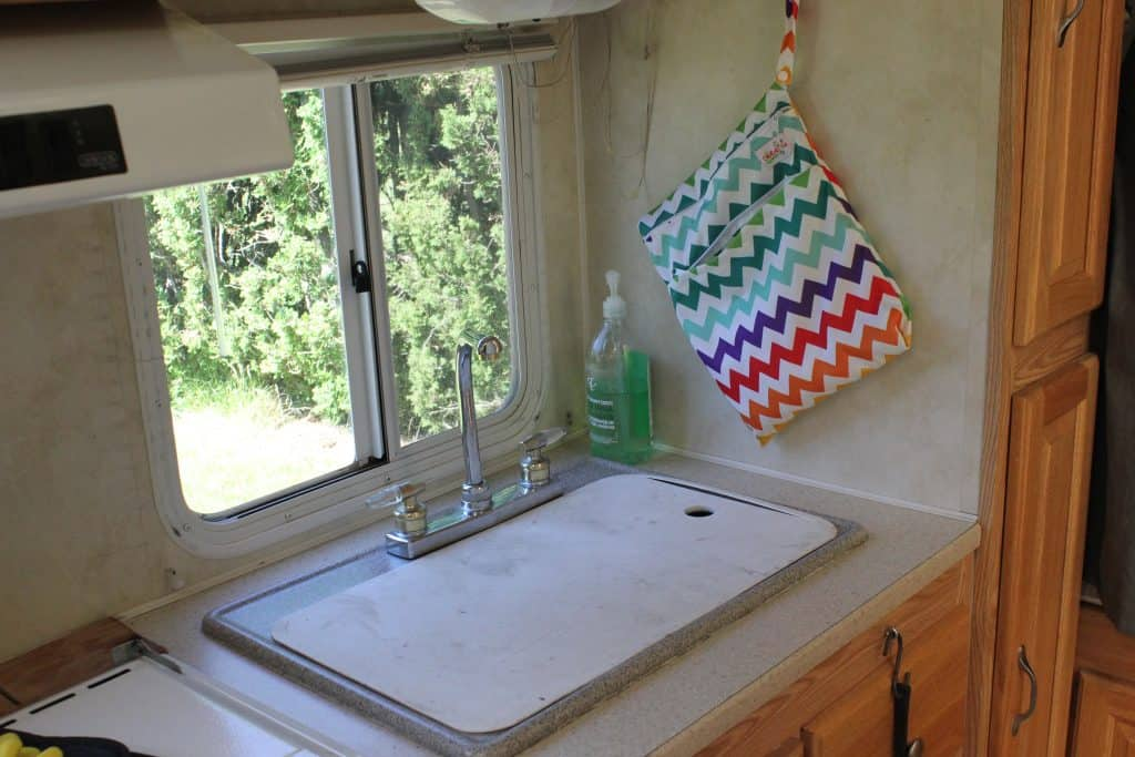 RV kitchen organization ideas - maximize counter space by covering sink