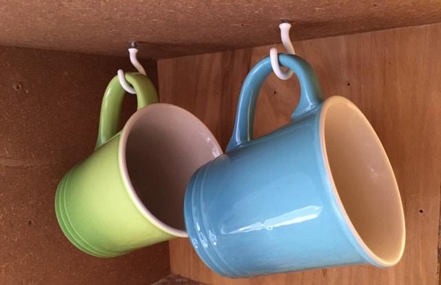 Simple Kitchen Cabinet Organization Idea - use hooks to hang coffee mugs.