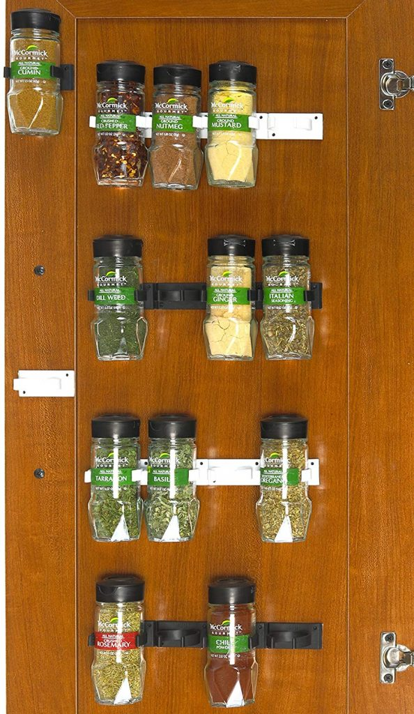Spice Storage Ideas - clip strips mounted to the back of a cabinet door. Another great spice rack ideas for small kitchens