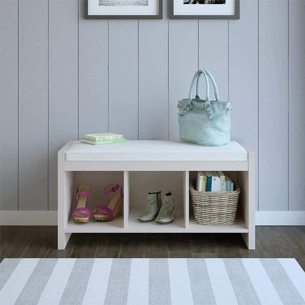 Entryway organization ideas - an entryway bench with storage cubbies below the bench.
