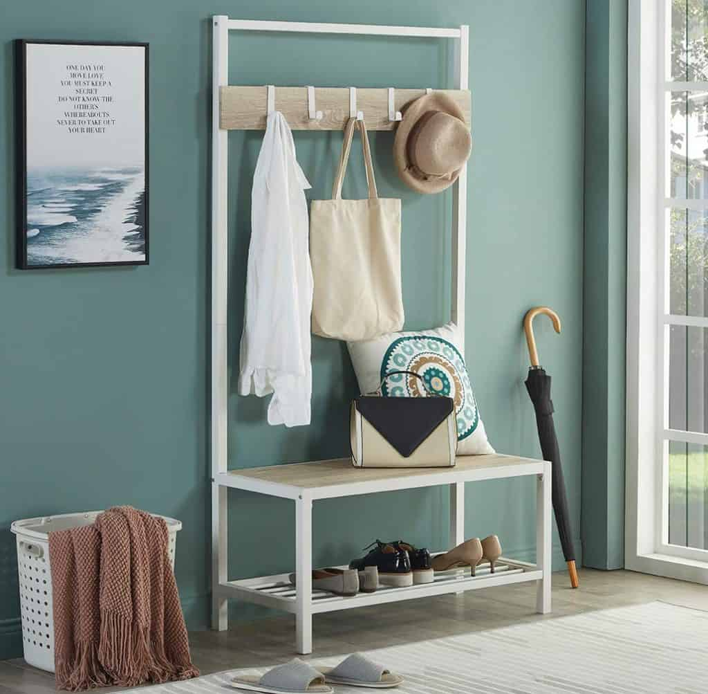 Entryway organization ideas - a white metal shoe rack, bench and coat hanger in one. Shoe racks with coat hooks