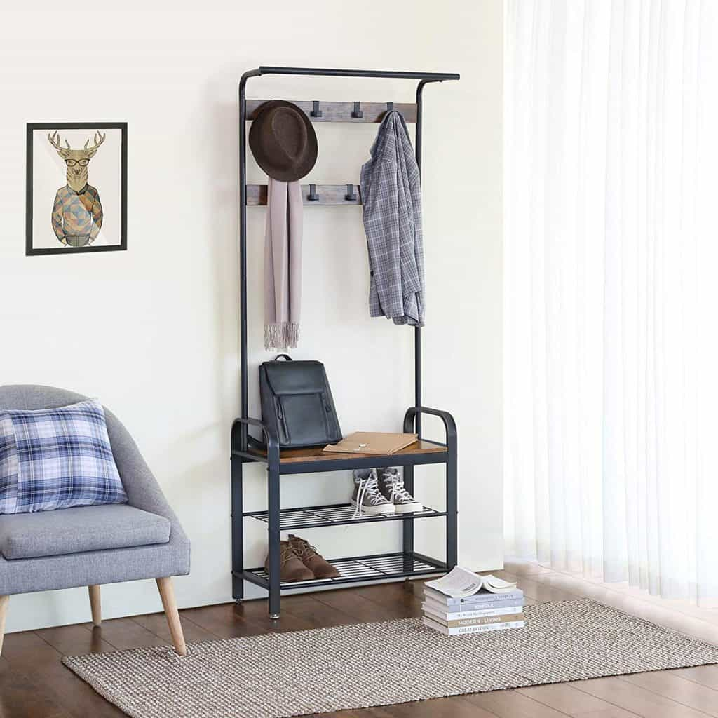 Entryway organization ideas - shoe rack and coat hanger in one unit. It is a stylish shoe rack with coat hooks.