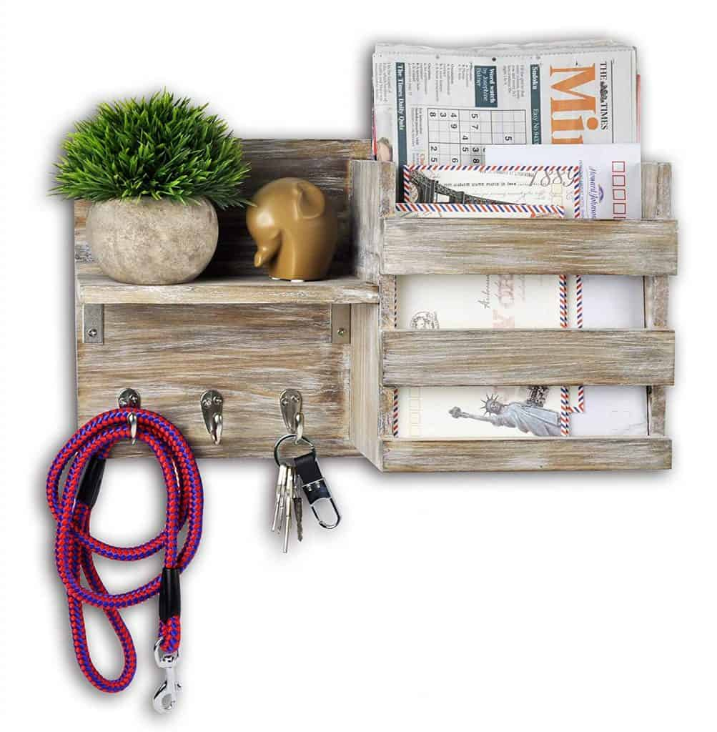 Entryway organization idea - have a wall mounted shelf and hooks for mail and keys and phone