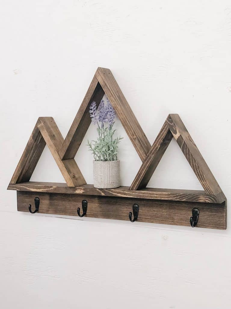 Mountain shape wall mounted coat rack with small shelves