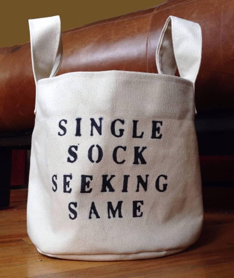 Single Sock seeking same laundry decor bag