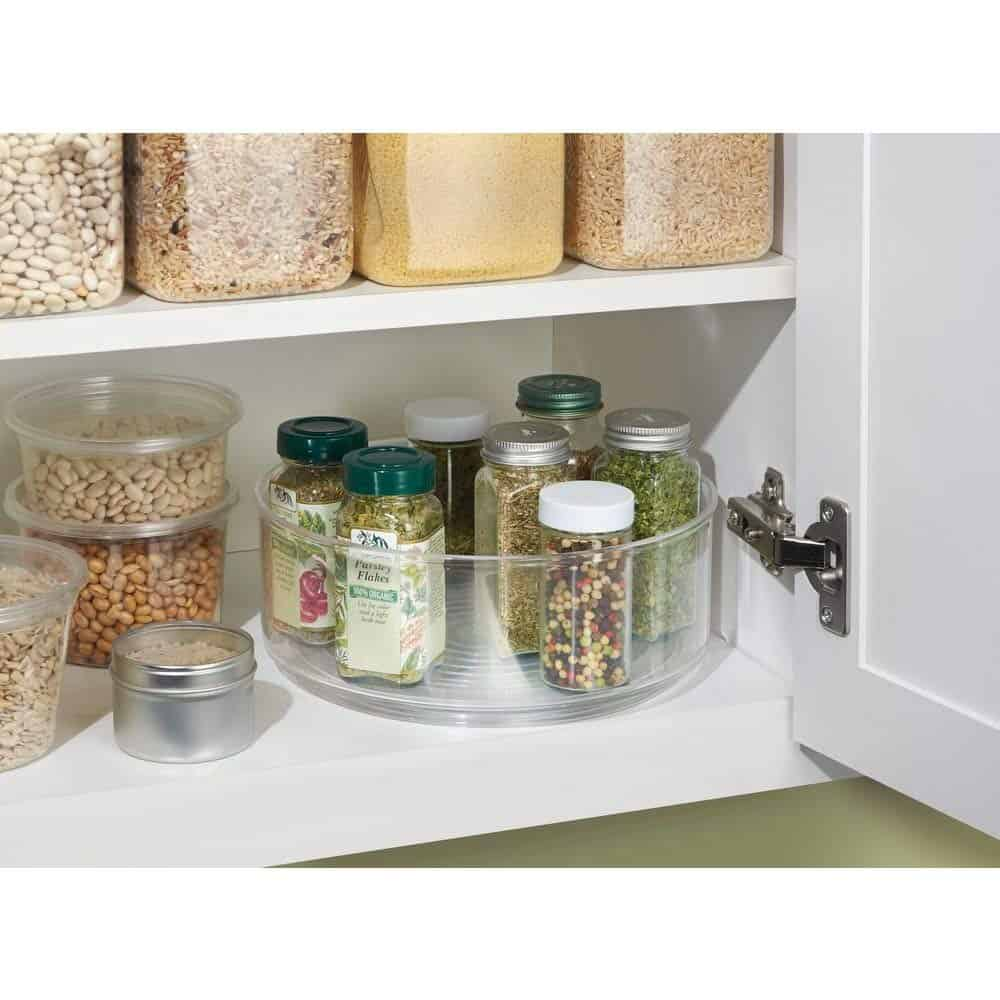 Spice storage ideas - lazy susan. A lazy susan like this can make a convenient spice rack idea for small kitchens because you tuck it into a cabinet and it keeps them off the counter.