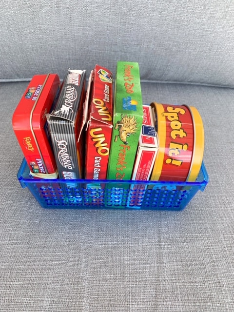 Game storage ideas - a plastic bin makes a handy board game storage container to keep in your RV