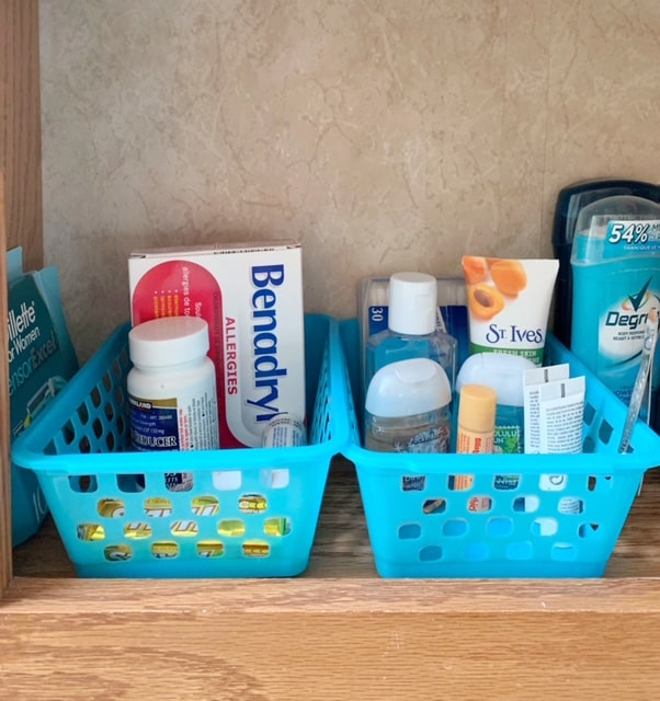 Plastic bins inside the RV medicine cabinet can help organize medicines and toiletries