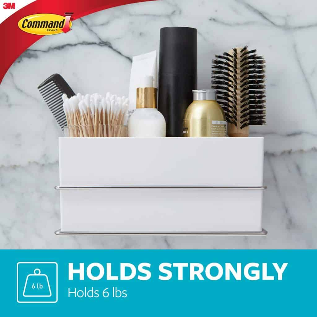 RV Bathroom organization ideas. A shelf like this from Command makes a great RV bathroom storage idea to help keep your personal care items off the counter.