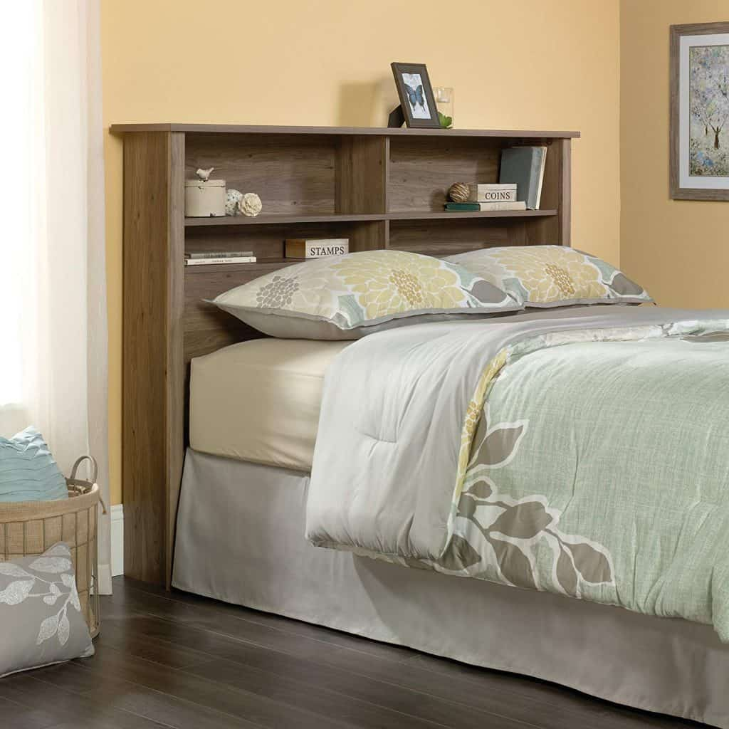 Bedroom organization ideas - a headboard with shelves provides some extra storage space