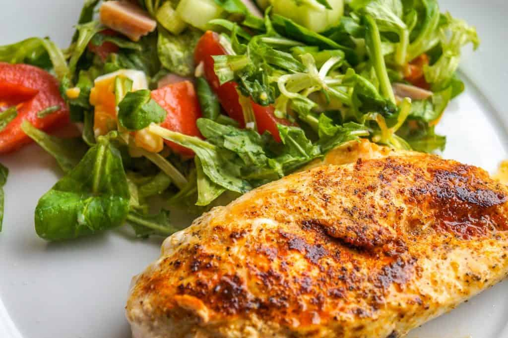 Paleo Lunch Ideas - cooked chicken breast served with salad