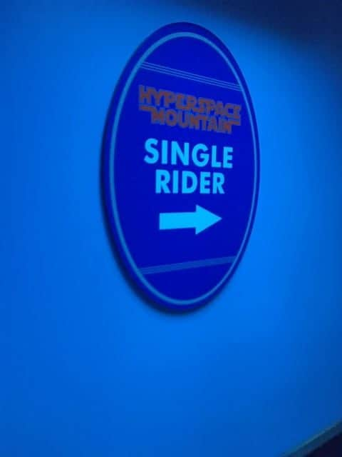 Going to Disneyland Alone - Hyperspace Mountain Single Rider sign. Hyperspace mountain is one of the best rides with single rider lines at Disneyland.