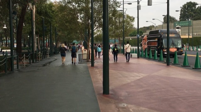 walking west towards the entrance to Disneyland and past the disneyland bus loop toward the security checkpoint