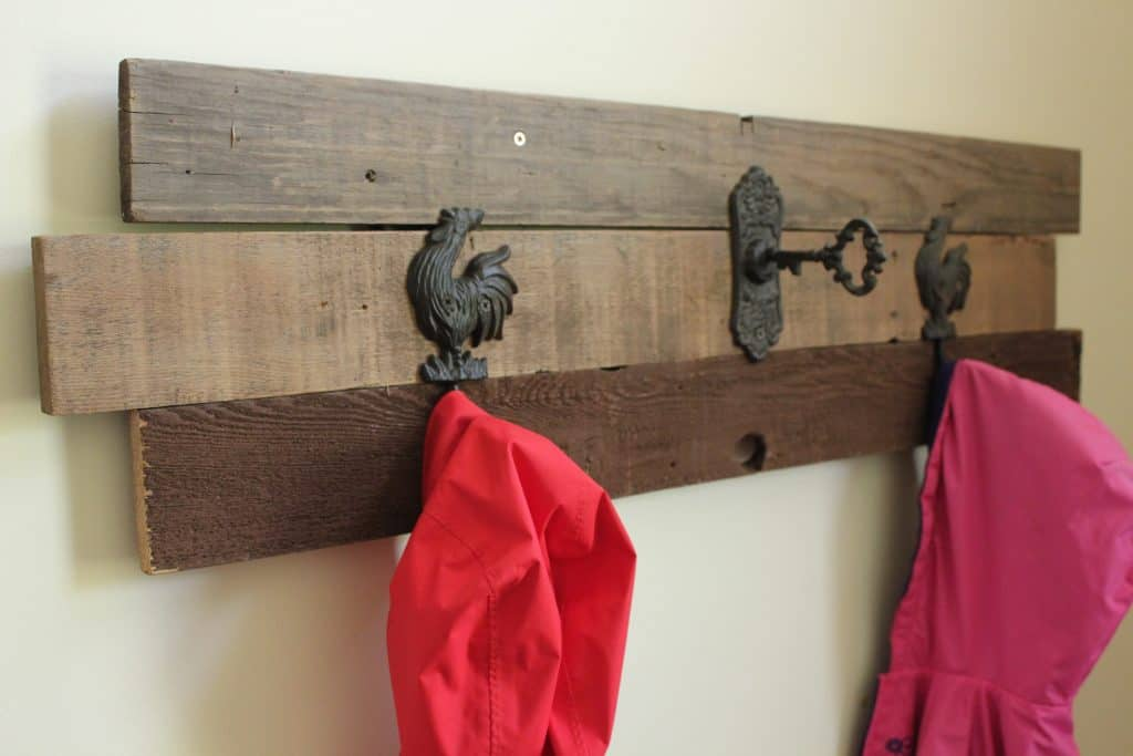 DIY Farmhouse Coat Rack that I built using old weathered boards and some farmhouse coat hooks.