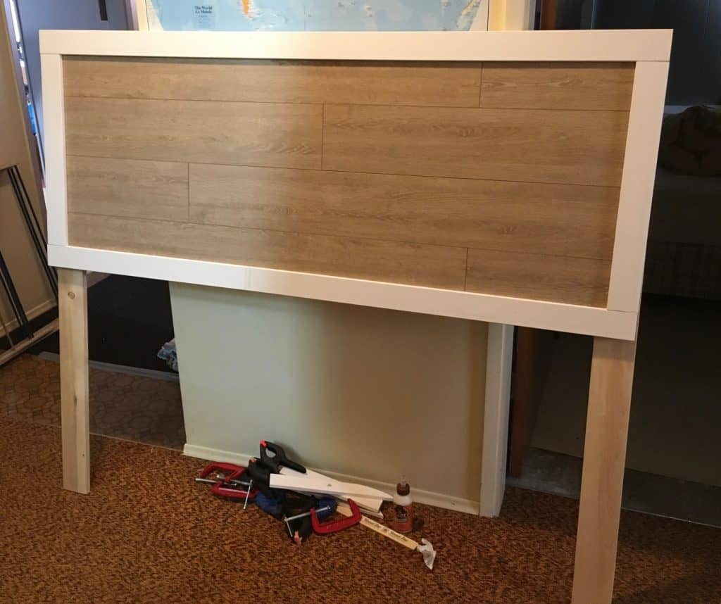 Here is a picture of my cheap DIY headboard with the laminate flooring and window trim pieces all completed.