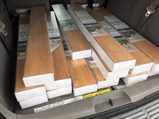 Our minivan loaded up with laminate flooring for the DIY bedroom makeover.