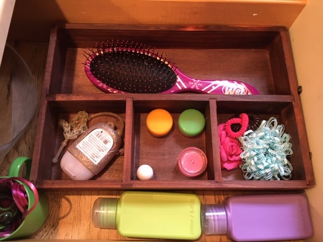 Organize bathroom drawer by using a divider tray