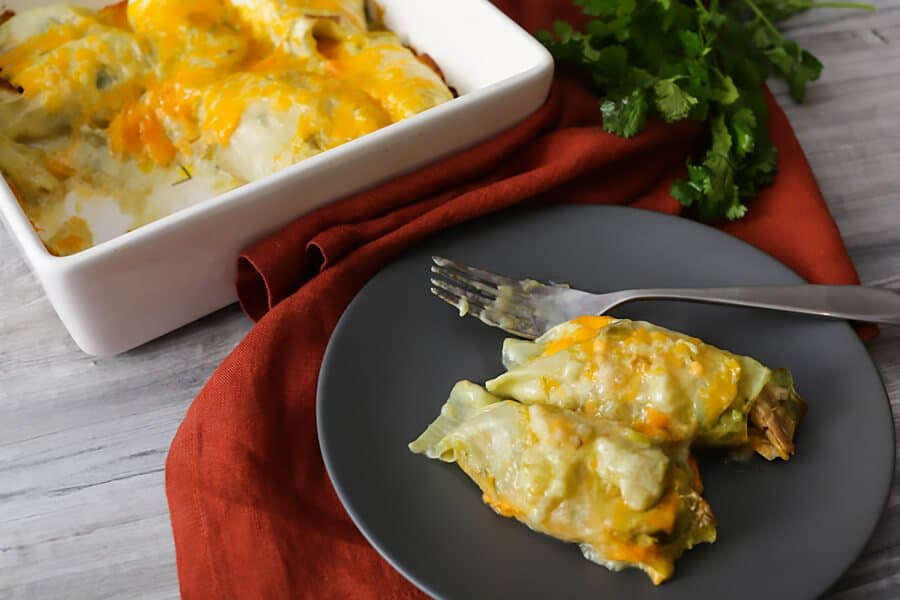Keto Chicken enchiladas with green chile sauce and softened cabbage as a wrap. from ruled.me website
