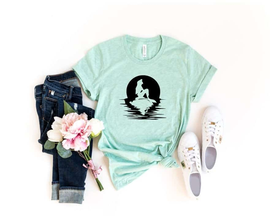 Disney Shirts for Women - Little Mermaid t shirt. Ariel sitting on a rock silhouette