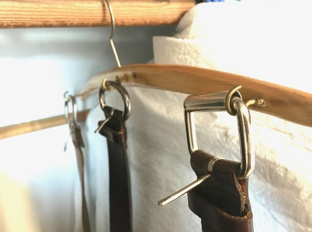 Closet Storage Ideas and Closet organization ideas - a DIY solution for hanging belts (hooks screwed into a wooden clothes hanger)