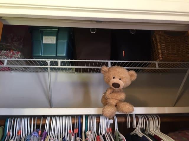 Add a shelf above your closet rod for extra storage space in your closet. An easy closet storage idea.