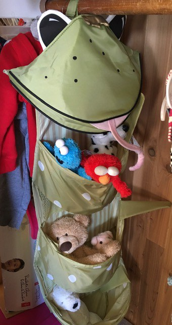 Hanging toy organizer for a closet