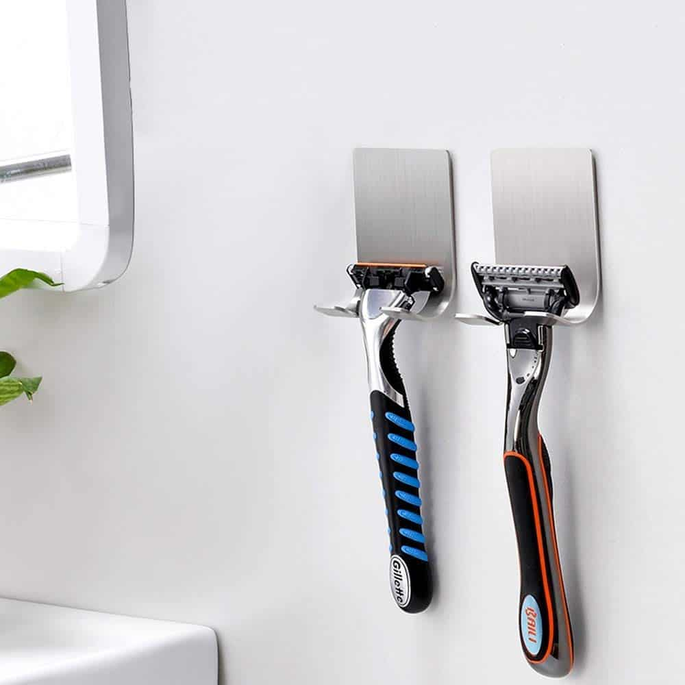 Wall mounted razor holder - sticks to the wall using an adhesive