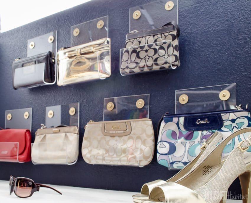 DIY closet organization idea of using acrylic sheets to hold purses.