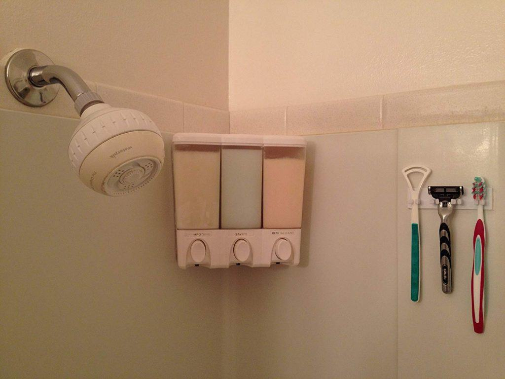 RV bathroom organization ideas - wall mounted toothbrush holder by HANG AWAY is a great camper toothbrush holder.