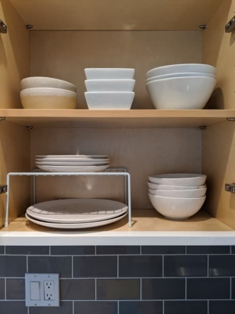 These dish risers or wire cabinet shelves are a great way to stack smaller plates above larger plates and allow you to better organize your dishes cabinet.