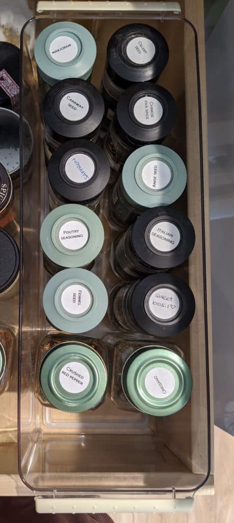 Spice Storage Ideas = label the top of your spice bottles and put them in a container inside a drawer or kitchen cabinet.