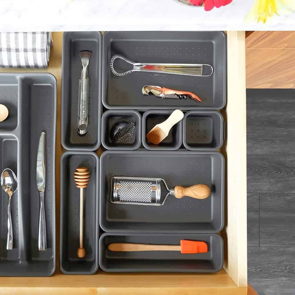 Kitchen drawer tray dividers and organizers help keep your drawers nicely organized.