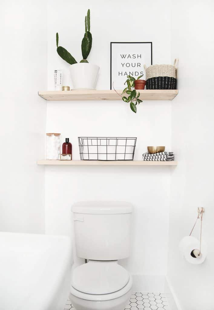 Shelves over toilet ideas. These open shelves provide good over the toilet storage space, but everything is in the open unless you have nice baskets to hide stuff.