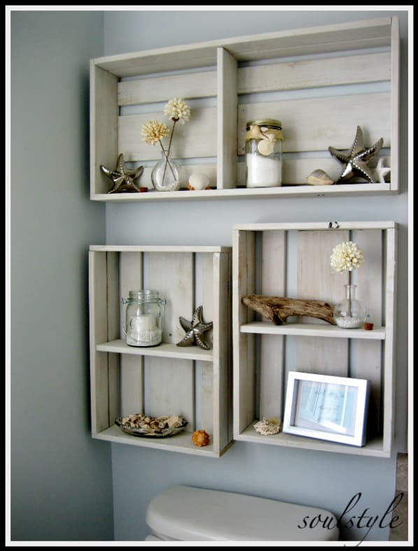 Bathroom shelves over toilet ideas - make your own shelves by putting shallow wooden crates on their side and screwing them to the wall.