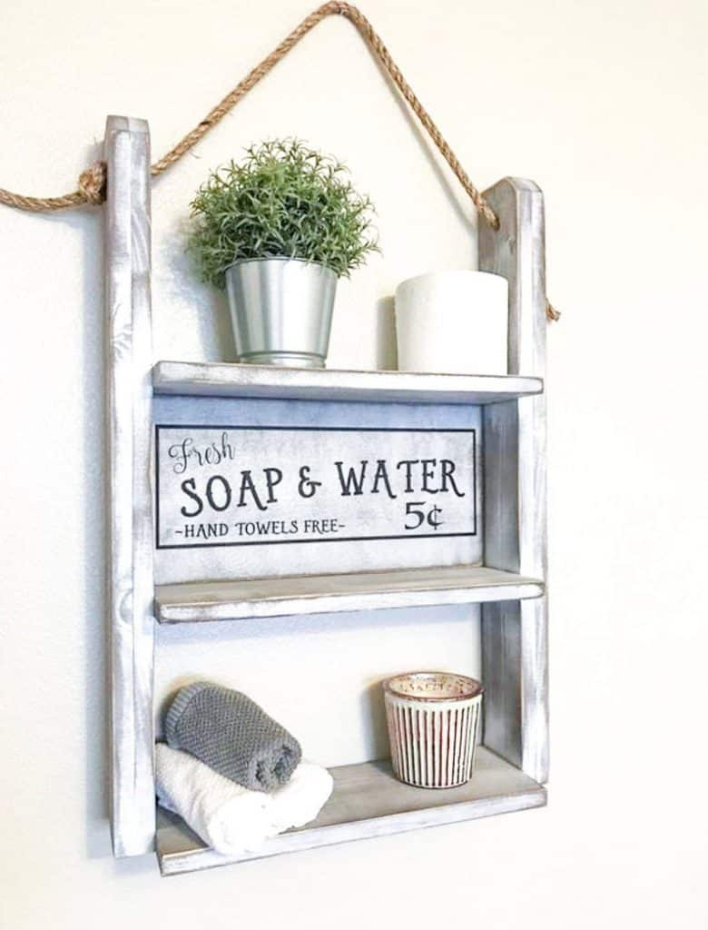 Shelving over toilet ideas - rustic looking wood and old rope shelves. Makes a good rustic over the toilet storage shelf, but it is open...so your stuff will be showing if that matters to you
