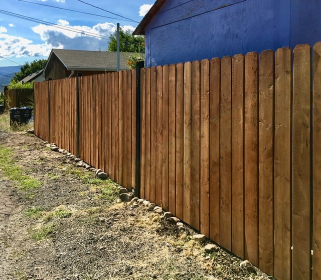 after replacing the rotten wood posts and installing new rails and pickets this is what it looks like.