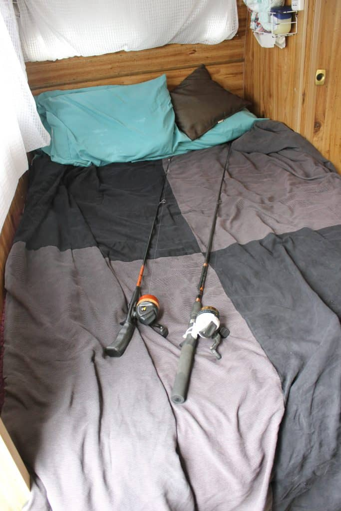 Where to store a fishing rod in an RV (lay it on the bed)