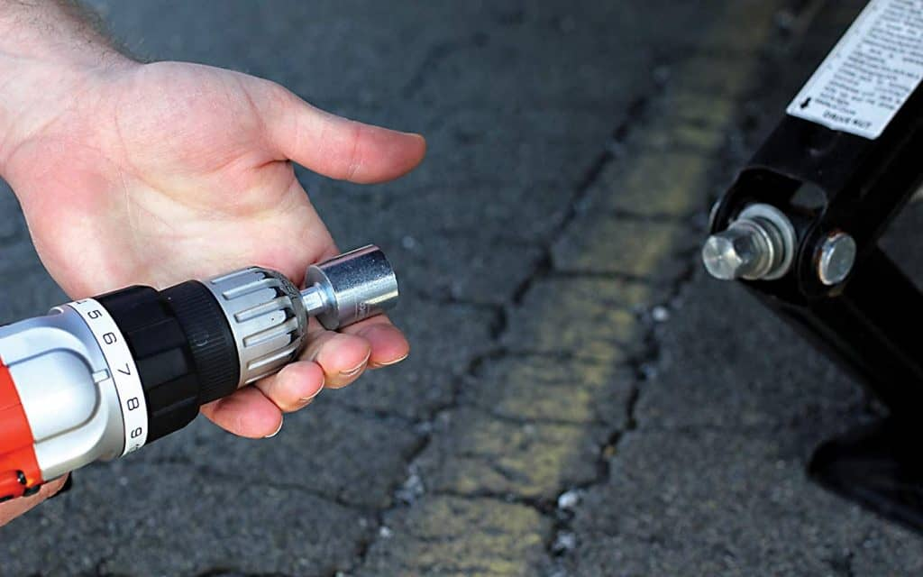 A drill adapter like this one makes quick work of raising and lowering the scissor jacks on your RV