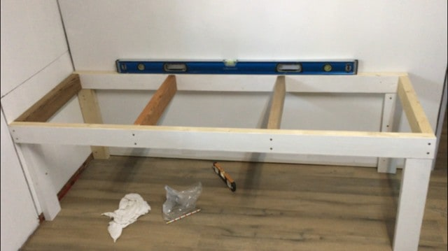 How to build strong storage shelves - i placed the shelf frame upon the bracing pieces and screwed the frame into the wall studs.